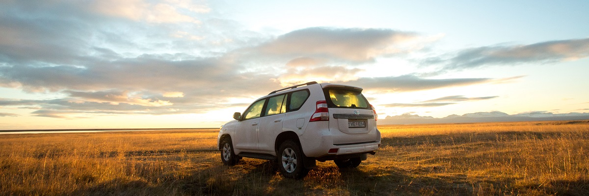 Toyota Landcruiser in a field in Iceland at sunset