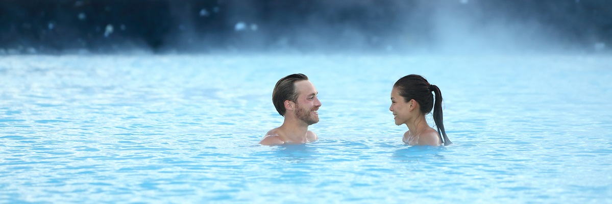 Couple enjoying a hot spring in Iceland
