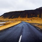 Open road on Snaefellsnes peninsula in Iceland with mountains