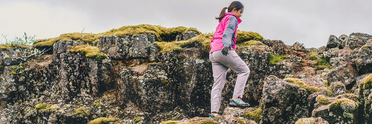 Woman hiking in Iceland in pink jacket